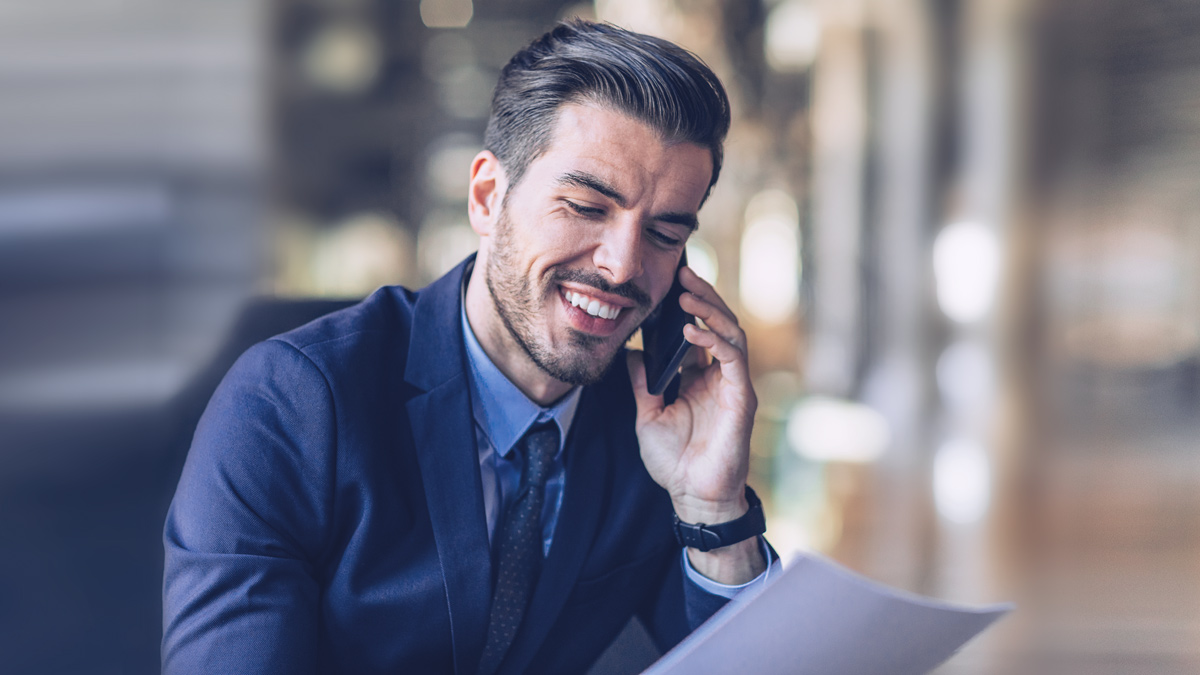 Business man laughing into his phone